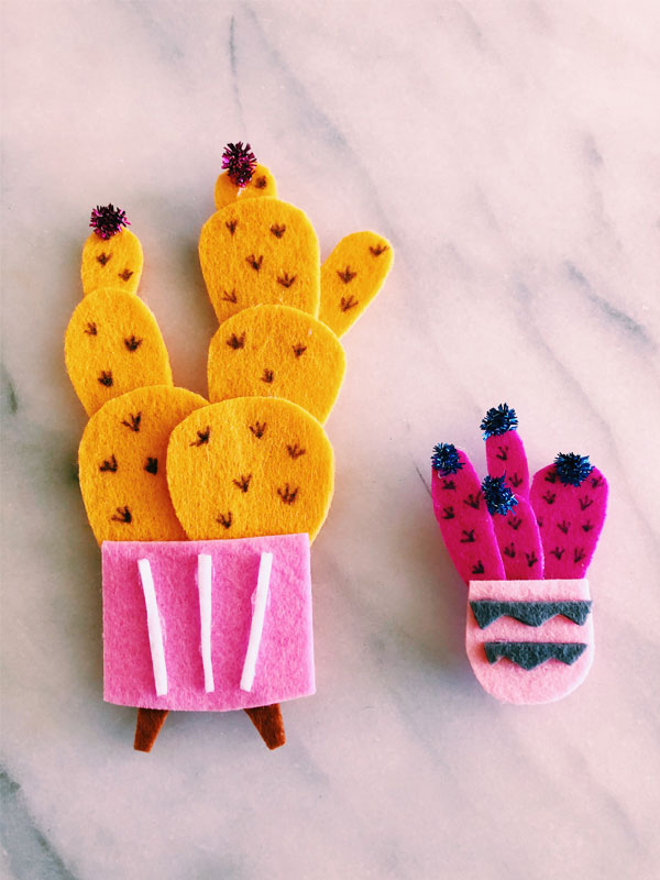 "After you build your cactus to the ideal shape, roll up a small piece of pipe cleaner to decorate the tops. If you don't have pipe cleaners, just cut out a little tuft of felt to decorate the tops- cut a tiny ""V"" with 3 points on top."