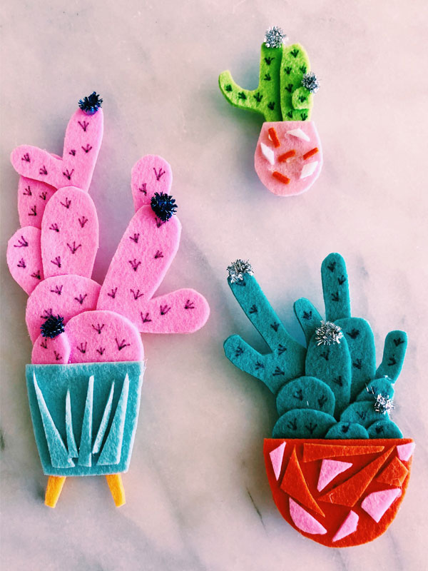 Use even the smallest felt scraps as little mosaic pieces to add pops of color to your cactus planters.