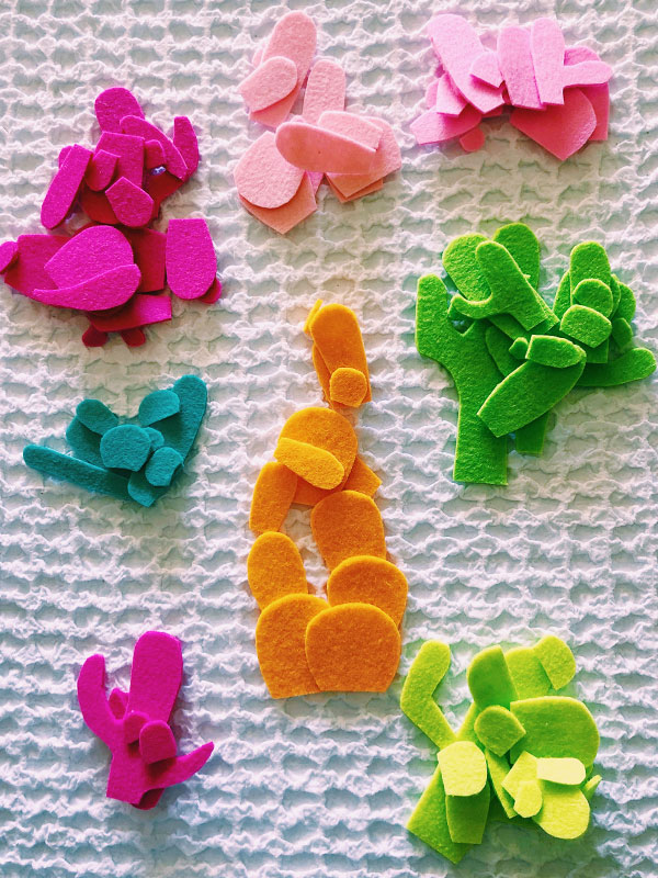 DIY cactus planter magnets - you can make these colorful magnets out of scrap felt. They're like little mid century pieces of candy for your refrigerator.